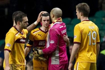 Jamie Murphy is comforted at the final whistle