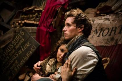 Samantha Barks and Eddie Redmayne star as Eponine and Marius in Les Miserables