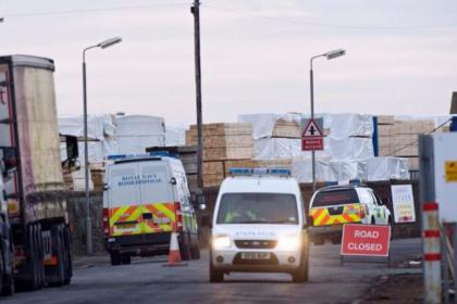 Police seal off the road to the harbour as the bomb squad investigate