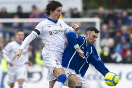 Francisco Sandaza battles for possession with Peterhead's Scott Ross