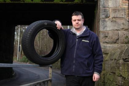 Taxi driver Gary Thomson's tyre burst on a pothole beneath Kennishead Train Station bridge