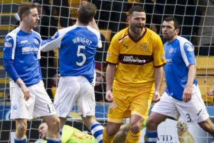 Michael Higdon celebrates after scoring his third goal of the game to put Well three goals to the good at Fir Park