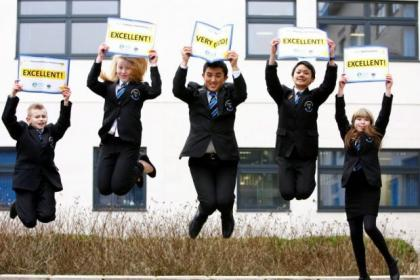 Frankie Dobinson, Fiona Glen, Elshan Fakahiany, Byron Yip and Morgan Butler jump for joy with Bishopbriggs Academy's impressive marks