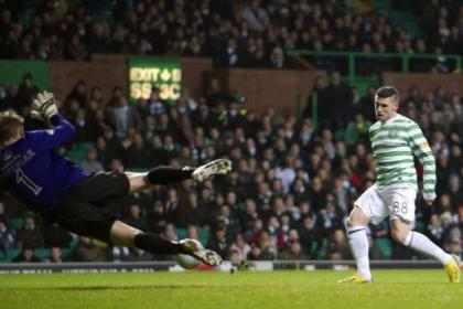 Gary Hooper opens the scoring for Celtic during their 4-0 win over Dundee United last night