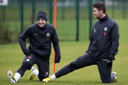 Charlie Mulgrew, right, is hoping his team-mate Gary Hooper will remain at Parkhead