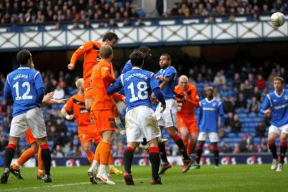 Gavin Gunning rises above the Rangers defence to score the opener for Dundee United in their 2-0 Ibrox cup win last year