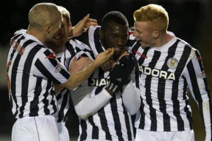 St Mirren striker Esmael Goncalves celebrates his opening goal with his team-mates during their 2-1 win over Inverness