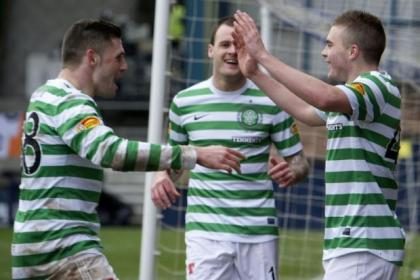 Gary Hooper and Anthony Stokes celebrate with goalscorer James Forrest
