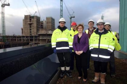 Ms Sturgeon is joined by graduates working on the new hospital project in the South Side of the city Picture: Mark Mainz