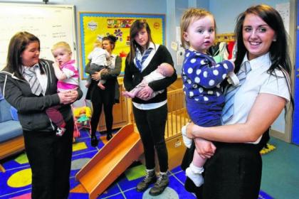Smithycroft pupils with their children at the Young Parents Support Base nursery at the school.