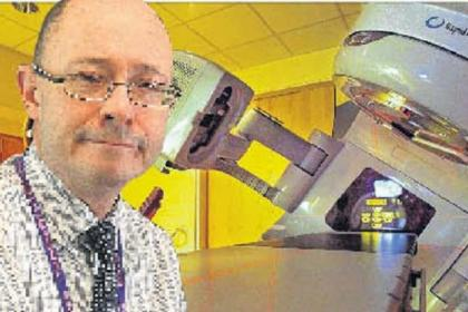 n Dr David Dunlop, left, and one of the new linear accelerators n Our front page from last Wedneasday