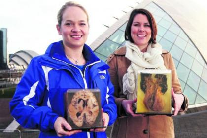 Jenny Templeman, left, and Sarah Gibb, hold a human heart and a human brain, ahead of the exhibition