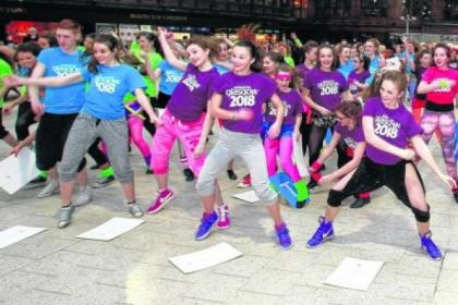 The games 'flash mob' show their delight at Central Station