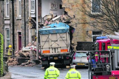 One woman was killed when the coal lorry crashed into the building