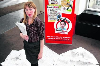 Caroline Wilson with the petition that was praised by committee convener David Stewart