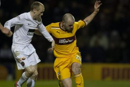 Motherwell's new signing James McFadden holds off Dundee United's Willo Flood last night. Picture: SNS