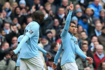 Carlos Tevez celebrates after netting Manchester City's second goal against Chelsea