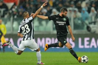 Joe Ledley gets in a shot despite the attentions of Juve's Arturo Vidal