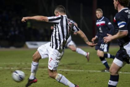 St Mirren midfielder Dougie Imrie scores the first goal for the Paisley side against Dundee at Dens Park