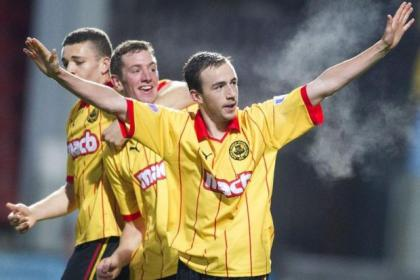 Jags players congratulate Stuart Bannigan after scoring against Livingston as he recognises the adulation of the Firhill fans