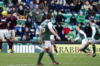 Leigh Griffiths takes the controversial free-kick which hit the bar and then bounced well over the line, but the goal wasn't given