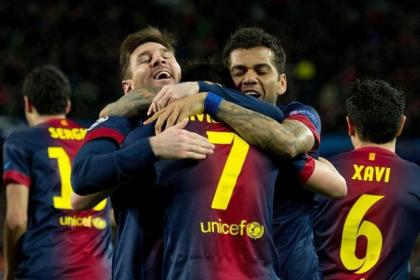Barcelona players celebrate their 4-0 win over AC Milan