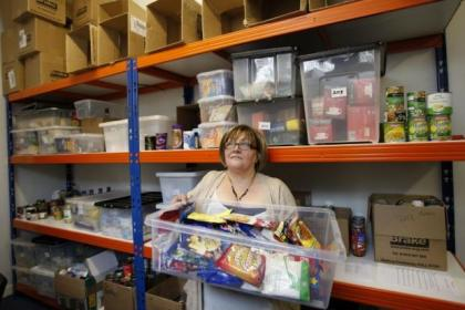 Govanhill food bank manager Audrey Flannaghan collects supplies at the Elim Church