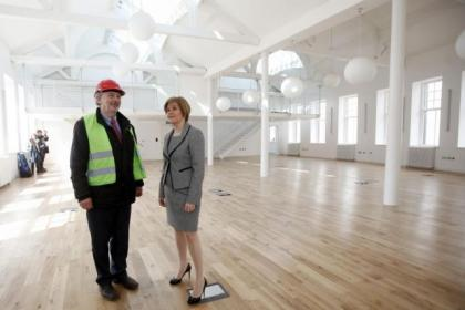 Project manager Pat Cassidy welcomes Nicola Sturgeon to Govan Workspace