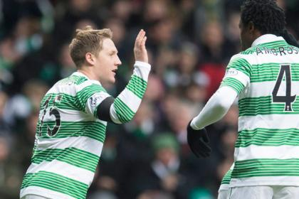 Celtic's Kris Commons celebrates scoring with team-mate Efe Ambrose (right)