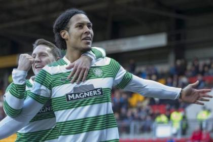 Virgil van Dijk celebrates his fine solo goal against St Johnstone on Boxing Day with team-mate Kris Commons