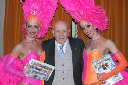 George Mulveny, 99, found himself centre stage with two showgirls when he went to the Pavilion Theatre to see this year's Christmas pantomime