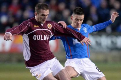 Ian Black battles for possession with Stenhousemuir's David Rowson during Gers' 2-0 victory