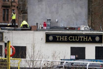 Workmen were on site at the tradgedy-hit Clydeside pub yesterday to install a temporary roof on the building