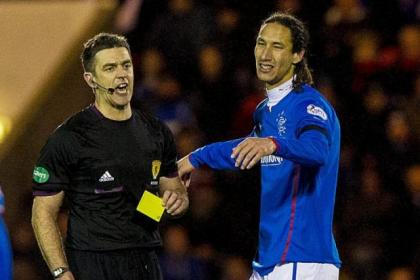 Rangers' Bilel Mohsni is shown a yellow card by referee Greg Aitken during last week's 1-0 win over Airdrie