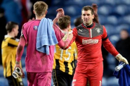 Rangers' Cammy Bell shakes hands with East Fife keeper Greg Robertson at the end of the game