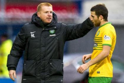 Neil Lennon gives Adam Matthews a hand following the 4-0 win in Paisley last weekend