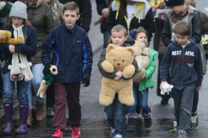 Children bring teddies and toys to the house in Fife where Mikaeel's body was found