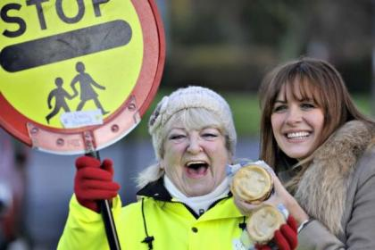 Carol Smillie surprises lollipop lady Dorothy Gaffney with a hot pie. Picture: Jamie Simpson