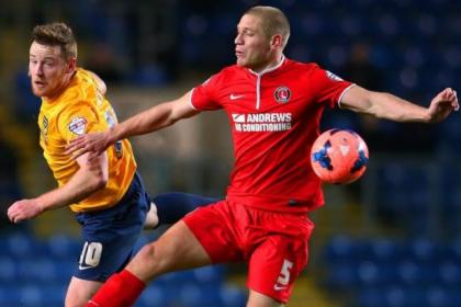 Michael Morrison, right, played in Charlton's 3-0 FA Cup replay win against Oxford on Monday night