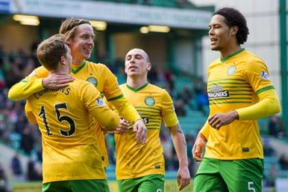 Kris Commons is congratulated by his team-mates Stefan Johansen, Scott Brown, and Virgil van Dijk after scoring  his second and Celtic's fourth goal from the penalty spot in their 4-0 victory over  Hibernian at Easter Road