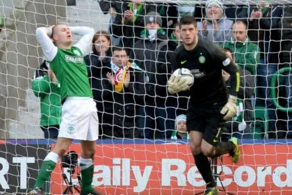 Dejection for Hibernian striker James Collins as Fraser Forster makes another save