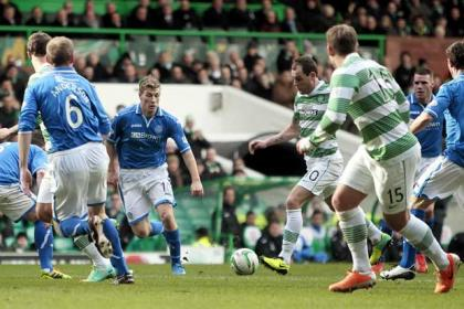 Celtic's Anthony Stokes scores a goal during the Scottish Premiership match