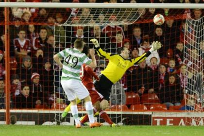 Celtic's James Forrest beats Jamie Langfield with a shot into the top corner of the net