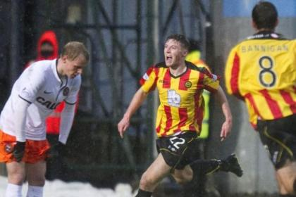 Gary Fraser wheels away to celebrate the second-half equaliser that earned Partick Thistle a share of the points against Dundee united
