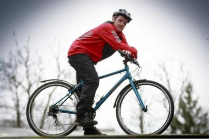 Robert MacGregor before he shed the pounds. Now he gets on his bike, right, to stay in shape