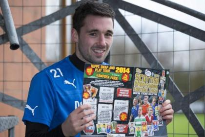 Nicky Clark promotes the official SPFL Topps sticker album at Murray Park yesterday