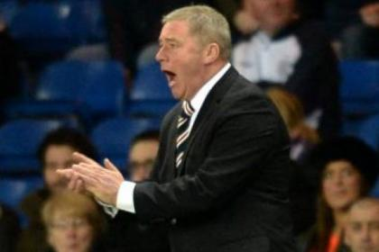 Ally McCoist urges on his side during 4-0 win over Dunfermline