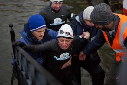 Davina McCall is helped out of the water at Lake Windermere
