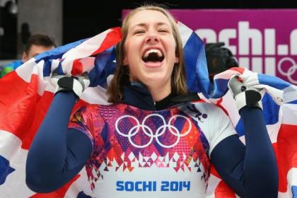 Lizzy Yarnold celebrates in front of the British fans after her headlong run to Olympic Games glory, earning team GB its first gold of the 2014 event