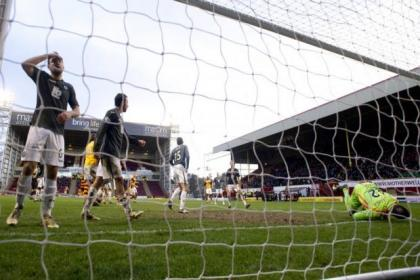 Partick Thistle players are deflated after throwing away points against Motherwell